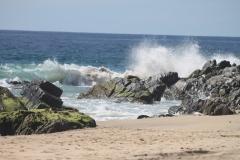 surf_on_rocks